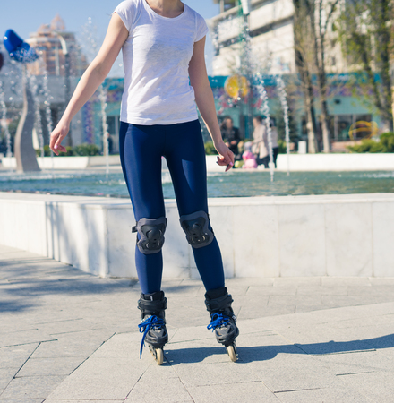 roller blade: young Roller Girl is learning how to skate