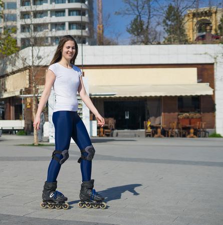 roller blade: happy Roller Girl skating in the park