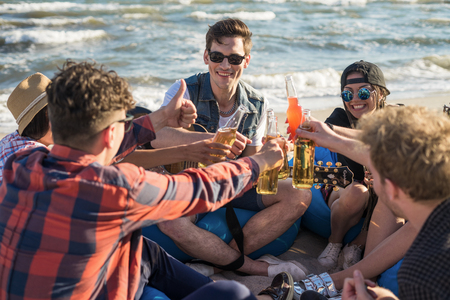 group of friends drindking on the beach party
