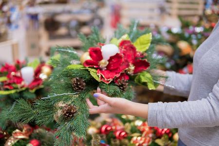 customer woman choosing Christmas decorations Stock Photo