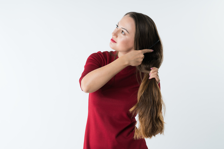 beautiful stylish young girl combs her hair with a comb.