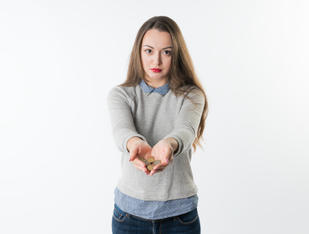 Woman hands holding euro coins and giving them to camera Stock Photo
