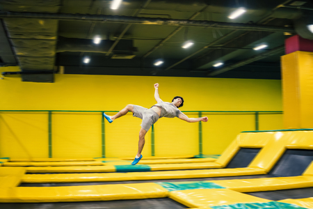 Trampoline jumper performs acrobatic exercises on the trampoline