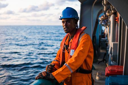 Seaman AB or Bosun on deck of vessel or ship , wearing PPE Banco de Imagens