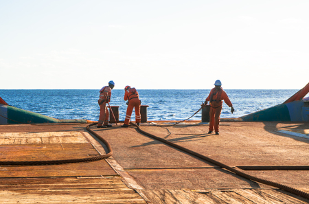 AHTS vessel doing static tow tanker lifting. Ocean tug job