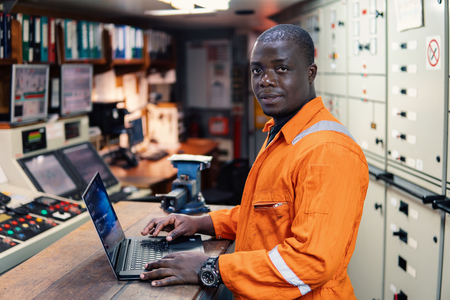 Marine engineer officer working in engine room Stockfoto