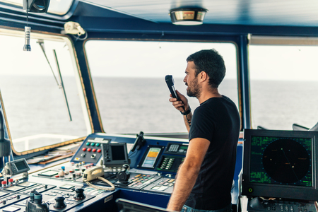 Marine navigational officer is reporting by VHF radio