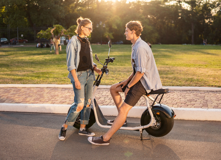 Lovely young happy couple with electric bike