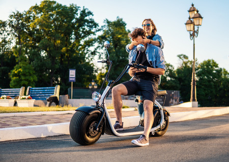 Lovely young couple dating with electric bike. Archivio Fotografico