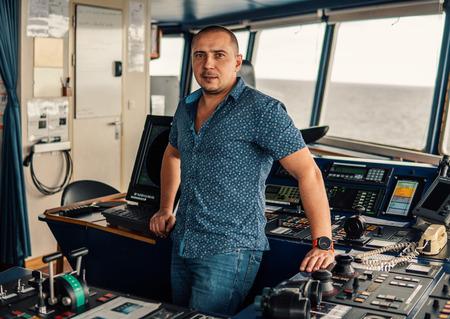 Marine navigational officer or chief mate on navigation watch Фото со стока