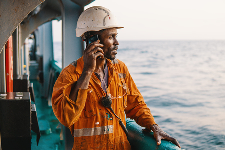 Bosun or AB seaman on deck of vessel or ship