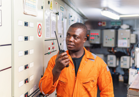 Marine engineer officer working in engine room Stock Photo