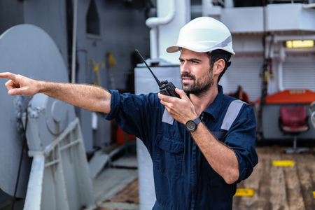 Marine Deck Officer or Chief mate on deck of vessel or ship Stock Photo