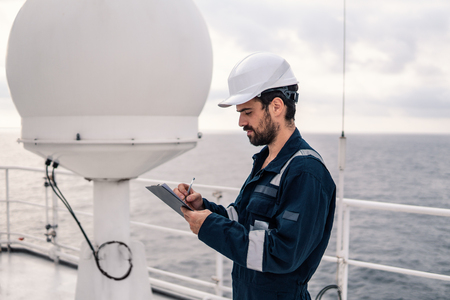 Service technician or serviceman near VSAT terminal Stock Photo