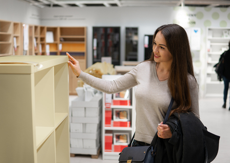 young beautiful woman finding herself new furniture, decoration