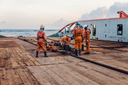Vessel crew preparing vessel for static tow tanker lifting