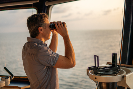 Navigational officer lookout on navigation watch at sea Stok Fotoğraf