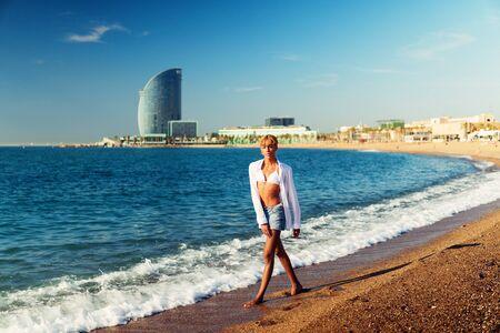 Beautiful shemale woman posing at the beach