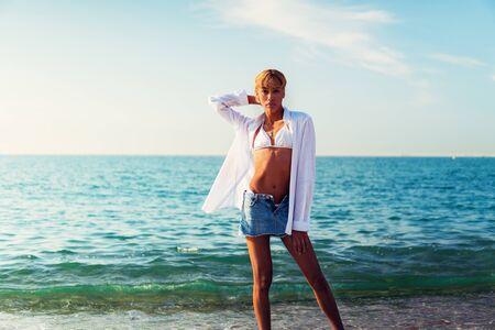 Beautiful shemale woman posing at the beach Stock Photo