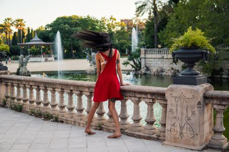 Ladyboy tattooed model is dancing in the green park