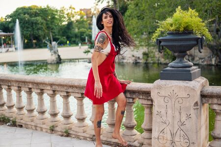Ladyboy tattooed model is dancing in the green park Stock Photo