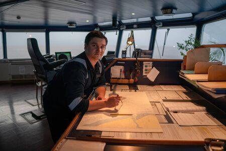 Marine navigational officer during navigational watch on Bridge Stock Photo