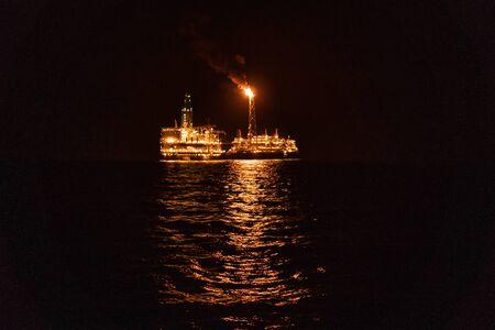 Night view of FPSO tanker vessel near Oil Rig