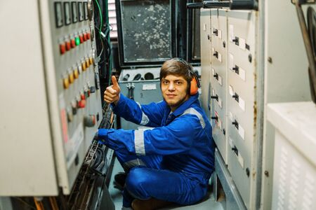 Marine engineer inspecting ships engine or generators
