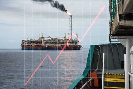Concept of growth up in offshore marine industry with rising graphics. Oil price increases. FPSO tanker vessel on oilfield