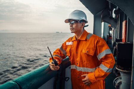 Filipino deck Officer on deck of vessel or ship , wearing PPE personal protective equipment