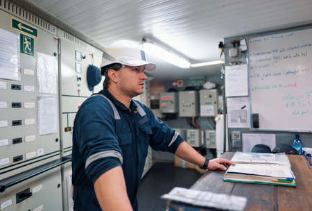 Marine engineer officer in engine control room ECR