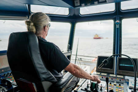 Captain of deck Officer on bridge of vessel or ship during navigaton watch at sea
