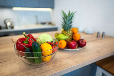 Fruits And Vegetables On The Table Of Modern Kitchen