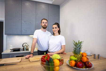 Couple Together In The Kitchen With Fruit And Vegetables 免版税图像