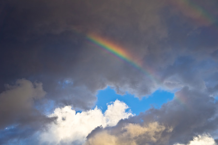 moody: Rainbow against the moody clouds