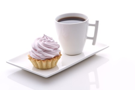 pink cakes and frash coffee on a white photo