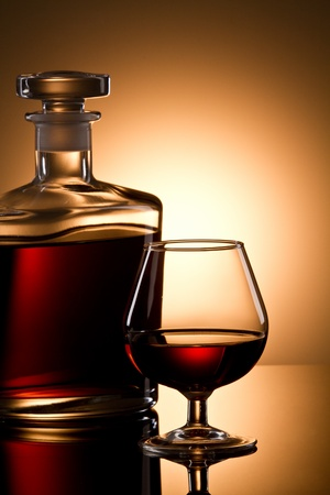 Still life with cognac glass and bottle photo