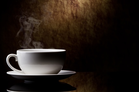 chinese tea pot: cup of coffee  on a old stone background.