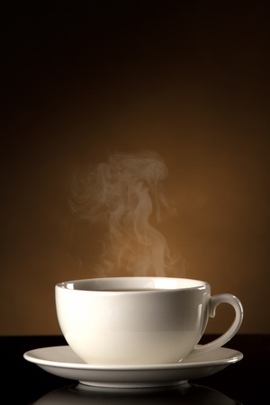 freshening: cup of coffee  on a old stone background.