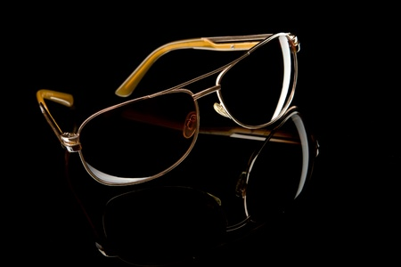 Sunglasses on black background Stock Photo - 10692589