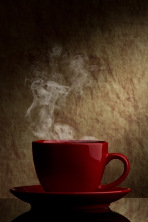 freshening: red cup of coffee  on a old stone background.