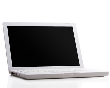 Modern laptop isolated on white with reflections on glass table. photo