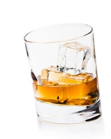 whisky and ice cube, a studio shot Stock Photo - 10692704