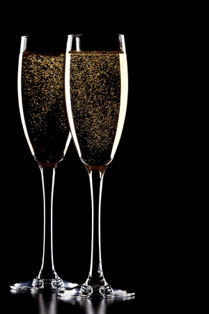 sparkling wine: A glass of champagne, isolated on a yellow  background.