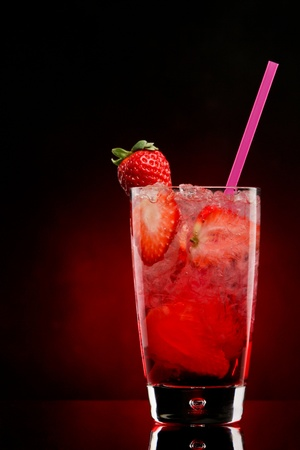 cocktail drinks: Strawberry cocktail with chrushed ice on a red gradient Stock Photo