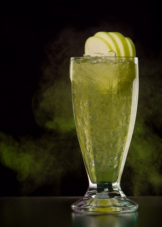 Green cocktail with apples and ice photo