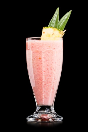Strawberry Pina colada drink cocktail glass isolated on black background photo