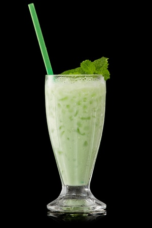 green mint cocktail on a black photo