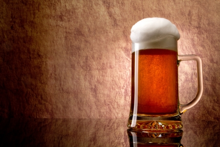 amber light: Beer into glass on a old stone