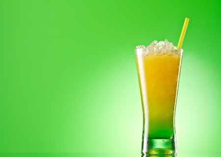 tall glass: Kivi Pina colada drink  cocktail glass isolated on green background